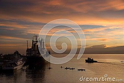 Sunrise over tropical port
