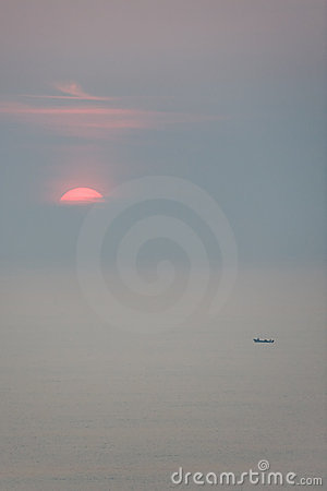 Sunrise over vast ocean