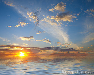 Sunrise over water and sky