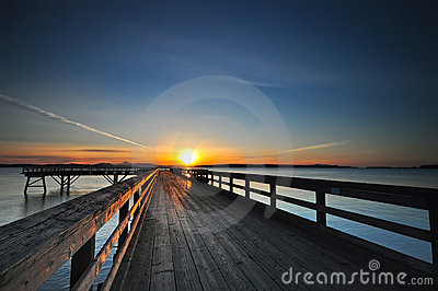 Sunrise over a wooden pier