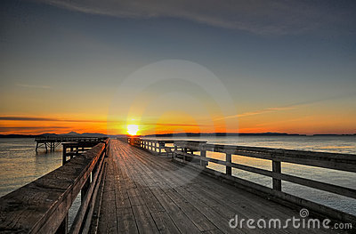 Sunrise over a wooden pier, Sidney, BC