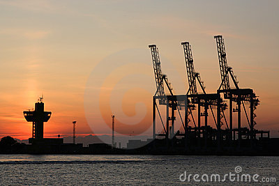 Sunrise and the port cranes