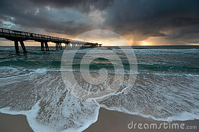 Sunrise with a rain over ocean.