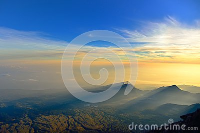 Sunrise rays of light on mountains and dramatic sky