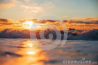 Sunrise reflection on waves