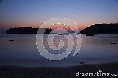Sunrise at rocky sea II