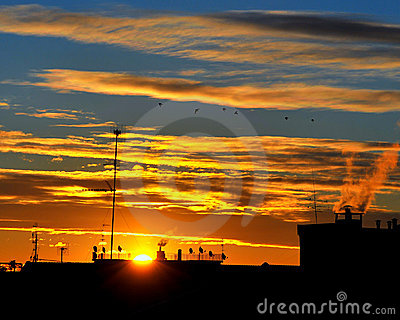 Sunrise on roofs and antennas