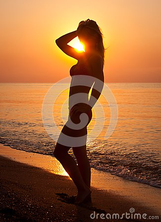Sunrise silhouette of a woman