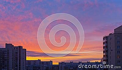 Sunrise sky over roofs