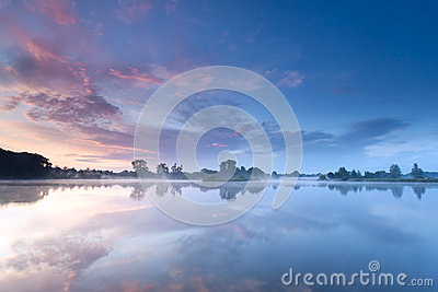 Sunrise sky reflected in river