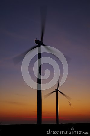 Sunrise and spinning wind turbines