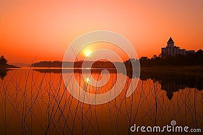 Sunrise Sunset over calm water