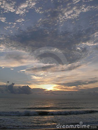 Sunrise with swirling ocean clouds