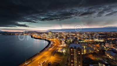 Sunrise timelapse. A timelapse of a sunrise over Reykjavik, Iceland with morning traffic and clouds moving