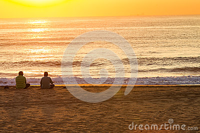 Sunrise Beach Men Sitting Editorial Photo