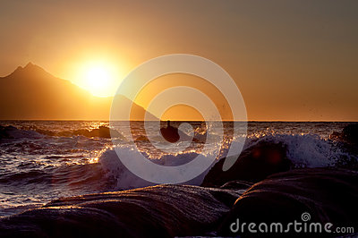 Sunrise, waves and Mount Athos