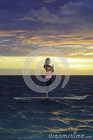 Sunrise yoga on paddle board