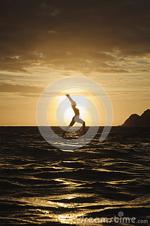 Sunrise yoga on paddle board