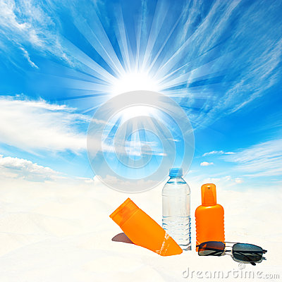 Free Sunscreen Cream And Bottle Of Water Over Sunny Blue Sky Royalty Free Stock Image - 45216796