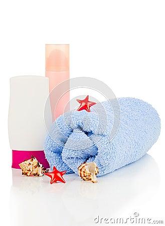 Sunscreen cream and bath towel