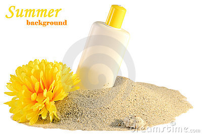 Sunscreen and flower on sand