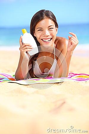 Sunscreen woman showing suntan lotion bottle