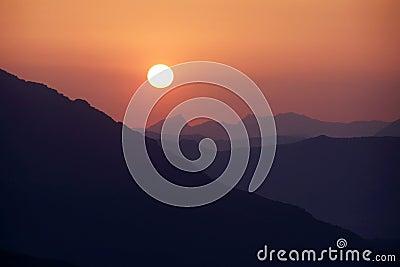 Sunset above mountain