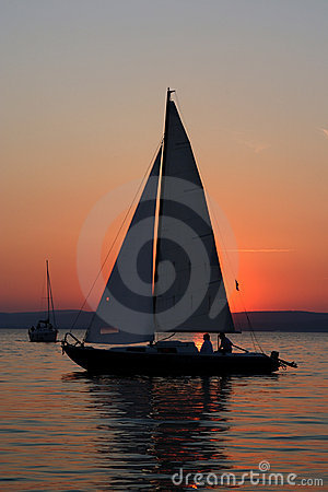Free Sunset And Boat With People Royalty Free Stock Image - 2770326