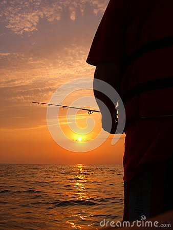 Sunset at the Baltic sea while fishing