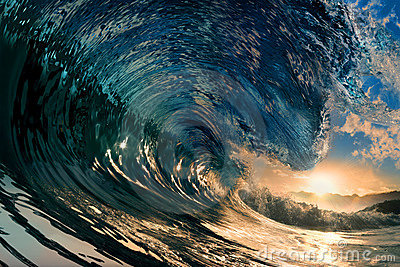 Sunset on the beach with ocean wave