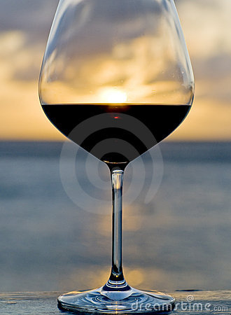 Sunset Behind a Glass of Red Wine
