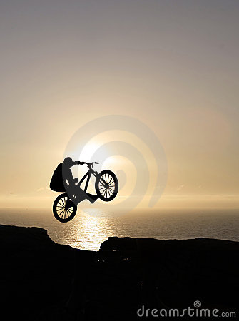 Sunset biker jumping