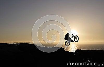 Sunset biker jumping