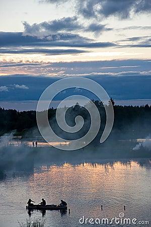 Sunset, boat and smoke