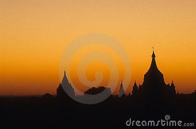 Sunset with Buddhist temples on horizon,