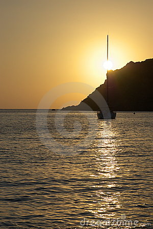 Sunset with cliff and yacht