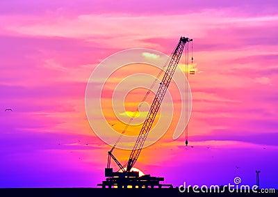 Sunset and crane