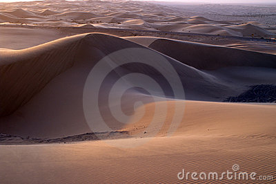 Sunset on desert sand dunes