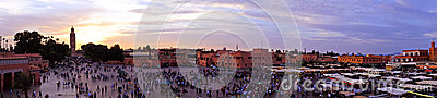 Sunset at Djemaa el Fna market in Marrakesh, Morocco, with Koutu