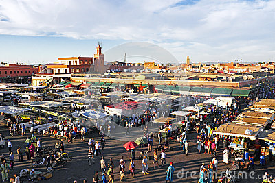 Sunset at Djemaa el Fna market in Marrakesh, Morocco, with Koutu Editorial Stock Image