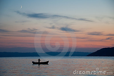 Sunset, fisherman  on his boat