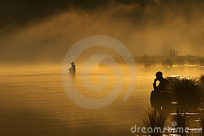 Sunset fishing in fog