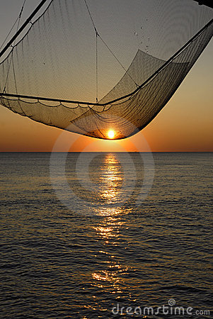 Sunset on fishing net carrelet