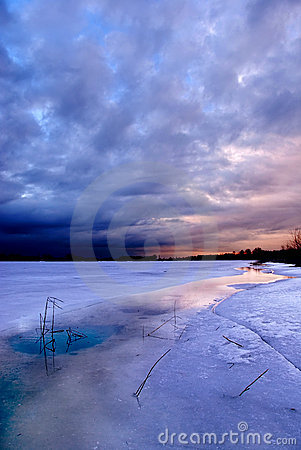 Sunset by a frozen lake