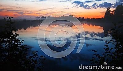 After sunset on gloomy lake