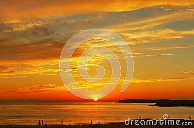 Sunset glow in sea level sky