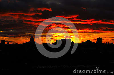 Sunset Glow and Silhouetted skyline of City