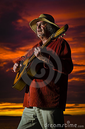 Sunset guitarist with dramatic lighting