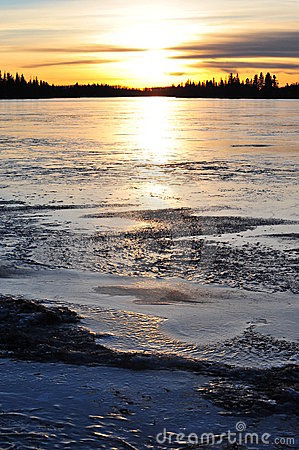 Sunset on ice lake