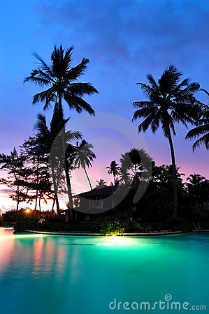 Sunset and illuminated swimming pool